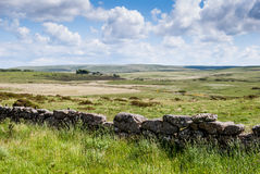 Typical dry stone wall on a farmland. Dry stone walls surrounding pastures and fields, UK Stock Images