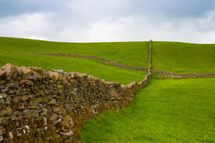 Typical dry stones wall on the pasture in Yorkshire Dales Royalty Free Stock Photo