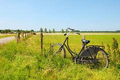 Typical Dutch. An old bike in Hollands landscape Royalty Free Stock Image
