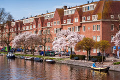 Typical Dutch apartment house at canal in Amsterdam Royalty Free Stock Photo