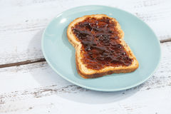 Typical Dutch apple syrup called Appelstroop on bread Stock Photos