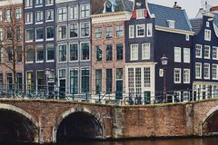 Typical dutch architecture, canal and bridge in Amsterdam royalty free stock photos