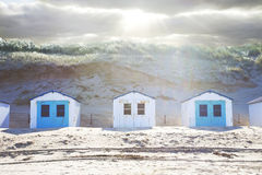 Typical Dutch beach houses. In a row stock images