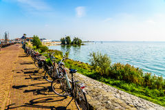 Typical Dutch Bikes parked at the promenade along the inland sea named IJselmeer Stock Images