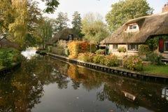 Typical dutch canal scene. In autumn season royalty free stock photos