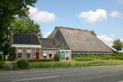 Typical Dutch farmhouse. With trees and a road Stock Photos