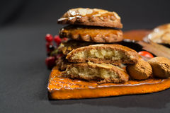 Typical Dutch filled spicy  cookies with almonds on autumn color Stock Image
