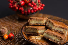 Typical Dutch filled spicy  cookies with almonds on autumn color Stock Photography