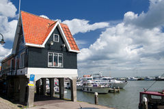 Typical dutch house at harbour Stock Photos