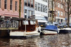 Typical dutch architecture, canals and boats in Amsterdam, Holla stock photos
