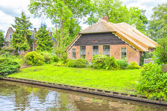 Typical Dutch houses and gardens in Giethoorn Royalty Free Stock Photography