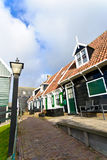 Typical Dutch houses with gardens in village Marken Royalty Free Stock Photos