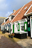 Typical Dutch houses with gardens in village Marken Stock Images