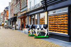 Typical dutch image of cow and cheese for sale Royalty Free Stock Images