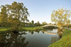 Typical dutch landscape. Canals, meadows and bridges in the countryside Stock Image