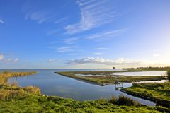 Typical dutch landscape. Water, dykes and wideness at the IJsselmeer in the Netherlands Stock Images