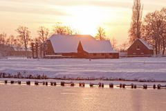 Typical dutch landscape. In winter the Netherlands at twilight royalty free stock photography