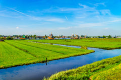 Typical Dutch Landscape with open Fields, Canals and Dutch Windmill Royalty Free Stock Images