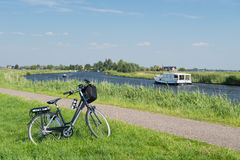 Typical Dutch landscape with river. Water and bike stock photos