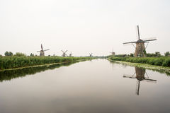 Typical Dutch landscape with windmills and water Stock Images