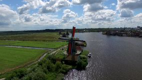 Typical Dutch landscapes. Aerials of typical Dutch landscapes with polder landscapes, orchards, farm landscapes and windmills stock video