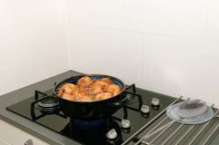 Typical Dutch oliebollen in hot oil Stock Photos