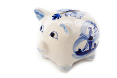 Typical dutch piggy bank. Typical dutch delft blue piggy bank  isolated on white Royalty Free Stock Image