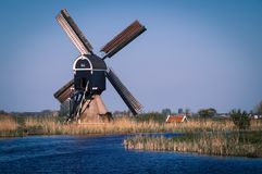 Dutch polder landscape with traditional windmill royalty free stock photo