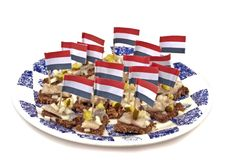 Typical dutch: Rye bread with raw herring Stock Photo