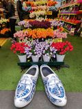 Typical Dutch shoes and tulips in the shop royalty free stock images