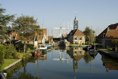 Typical Dutch small village. With sluice and harbor stock images