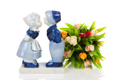 Typical Dutch souvenir. In Delft blue and plastic tulips  over white background Royalty Free Stock Image
