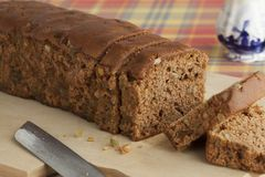 Typical Dutch spice bread with Succade, ginger, cinnamon, nutmeg. And cloves made in the province of Friesland Stock Photography