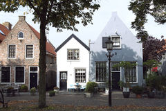 Typical Dutch street in Harderwijk, Netherlands. Old dutch houses in typical formal style Royalty Free Stock Photos