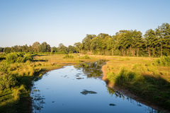 Typical Dutch Summer landscape in July near Delden Twente, Overijssel. The sun is slowly setting on a typical Dutch landscape in the summer month of July. This Royalty Free Stock Photos