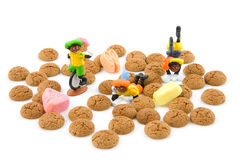 Typical dutch sweets; pepernoten ginger nuts. Typical dutch sweets pepernoten ginger nuts and zwarte pieten Royalty Free Stock Images