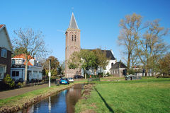 Typical Dutch village- with church - wooden houses Royalty Free Stock Photo