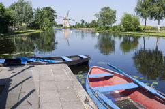 Typical Dutch vista with boats for rent. Royalty Free Stock Images