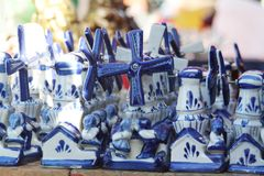 Typical dutch windmill. Typical dutch blue windmills souvenirs Royalty Free Stock Image