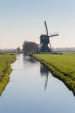 Typical Dutch windmill in backlight Stock Photo