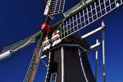 Typical Dutch windmill detail against a blue sky, Holland. Stock Photo