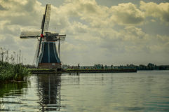 Typical Dutch windmill at a lake Stock Photos