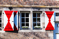 Typical Dutch window in Maastricht. Typical Dutch window at an old stone building in Maastricht, The Netherlands Royalty Free Stock Photography