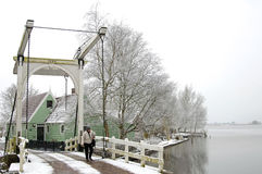 Typical Dutch winter landscape with lake and bridge Stock Photo