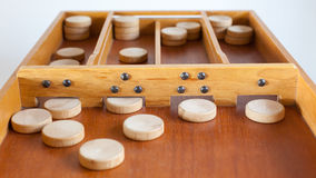 Typical dutch wooden boardgame - Sjoelen Stock Photo