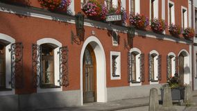 Typical elegant Austrian hotel with vacant rooms. Typical traditional Austrian hotel with sign vacant rooms (Zimmer frei), beautiful flowers on each window stock footage