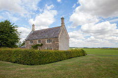 Typical English country cottage. Rural countryside farmhouse. Stock Photo