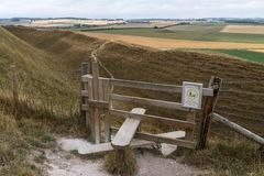 Typical english country stile with dog gate leading to meadow Maiden Castle Dorset Dorchester United Kingdom royalty free stock images