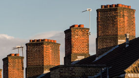 Typical English house chimneys Royalty Free Stock Photo