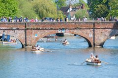 Typical English scene with people walking over a Bridge and boats passing underneath. Stratford upon Avon Warwickshire England UK May 6th 2018 bank holiday royalty free stock image